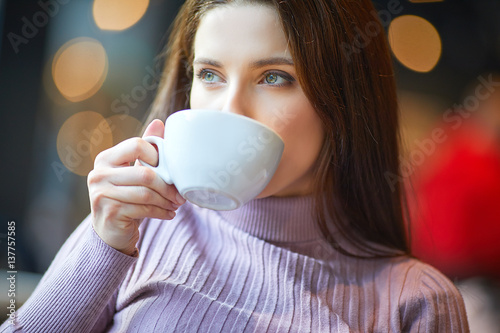 woman working with laptop in cafe. social network concept