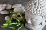 buddha head with stones , bamboo and tabular