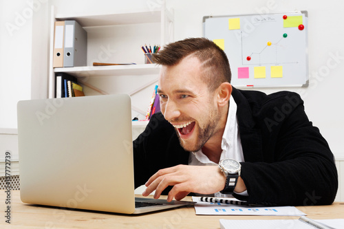 Poster Young businessman gambling and gaming in the office