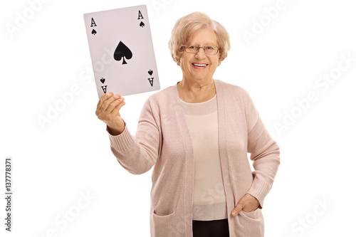 Happy mature woman showing an ace of spades card Poster