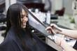 Changes hairstyles. Woman in a hair salon, Haircut