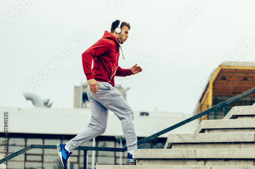 Handsome man running up at stairs