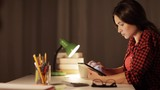 student girl or woman with tablet pc at night home
