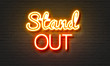 Stand out neon sign on brick wall background.