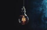 Vintage lightbulb on dark background - 137862166