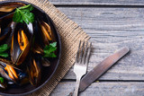 Mussels with parsley in pan