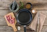 Sirloin steak and ingredients against wooden background