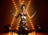Girl - DJ, in an unusual helmet raised her hands up