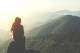 silhouette woman sitting on mountain in morning and vintage filter