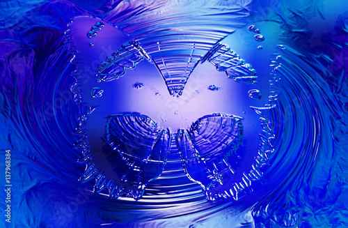 Butterfly on blue background. Glass and metal effect and swirl.