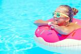Tween girl in resort pool