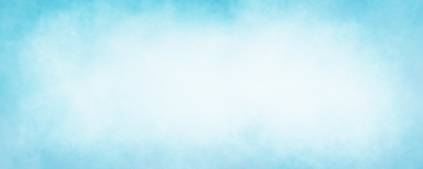 pastel sky blue background with soft puffy cloudy white center with faded vintage textured border