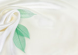 White silk drapery with green leaves