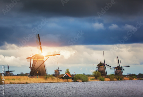 Windmills against cloudy sky at sunset in famous Kinderdijk, Netherlands Canvas