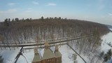 Traditional Ukrainian village in winter, Pirogovo architecture museum, aerial view, raw, 4K
