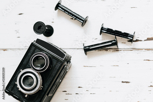 Retro medium format camera on wood table background, vintage concept