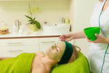 Woman having algae mud mask on face