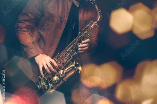Poster Jazz saxophone player in performance on the stage