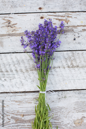 Foto op Canvas Lilac lavender on a wooden background. Medicinal plant in bloom.