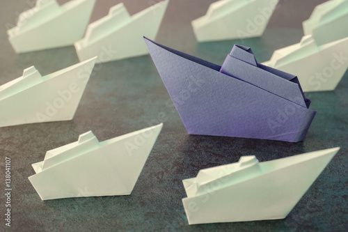 Origami paper ships, change business concept, toning