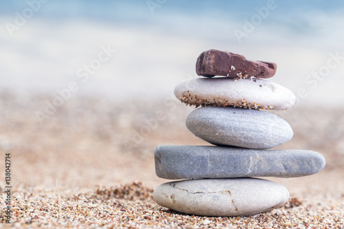 Foto op Plexiglas Stenen in het Zand Pile of stacked stones on the sandy beach at Adriatic sea