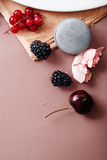 Macarons and blackberries. Top view with copy space.