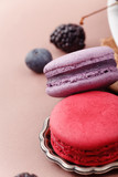 Soft pink and purple macarons with berry taste close up