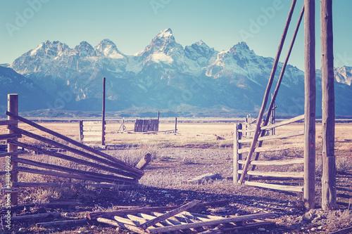 Vintage stylized wooden gate with mountain view, Grand Teton National Park, USA.w.