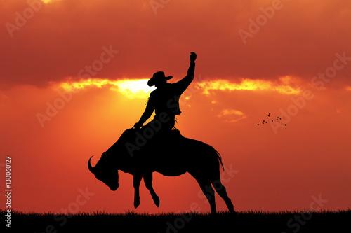 Foto op Canvas Baksteen bull rider at sunset