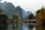 Bamboo rafts on Yulong river near Yangshuo town in Guangxi province, China. Rafting is a popular attraction among domestic and foreign tourists.
