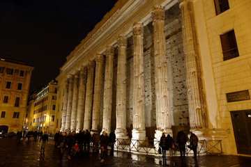 Walk in Rome by night among ancient monuments.