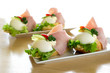 Traditional European open egg and ham sandwiches on white ceramic plates.