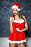Sexy santa woman holding whip