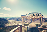 Color toned photo of binoculars looking out over a valley, selective focus, Glenwood Springs, Colorado, USA.