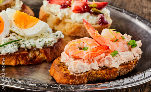 Gourmet prawn canape on cream cheese