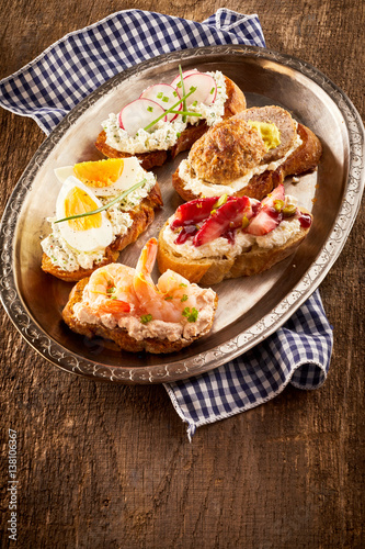 Assorted bite-sized canapes or bruschetta