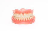 Two acrylic dentures ,white background. - 138107591