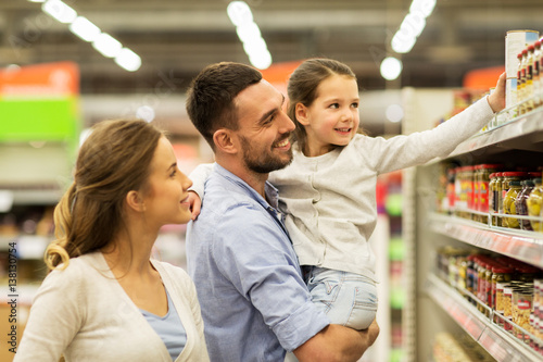 happy family buying food at grocery store