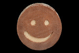 Round wafer carved smile