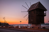Old windmill on the promenade at sunset in Old Nessebar, Bulgaria.