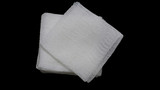 gauze pads on the black background