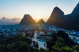 Yangshuo sunset cityscape skyline with Karst mountains in Guangxi Province, China