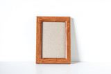 Blank wooden photo frame on the shelf