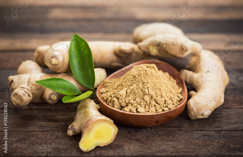 Ginger root and ginger powder in the bowl - 138228563