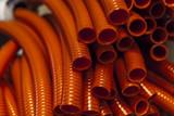red plastic hoses - 138238393