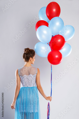 Wwoman wearing beautiful dress with a lot of colorful balloons Poster