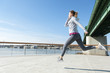 Women running on bridge