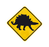 Yellow traffic label with dinosaur pictogram isolated