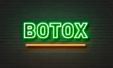 Botox neon sign on brick wall background. - 138287380