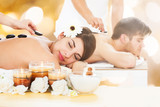 Couple In A Spa Getting Hot Stone Therapy
